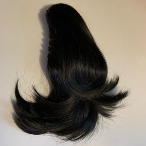 Beautiful natural looking black Clip on ponytail